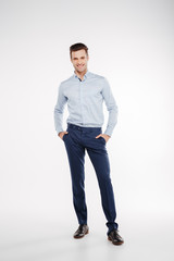 Vertical image of man with arms in pockets