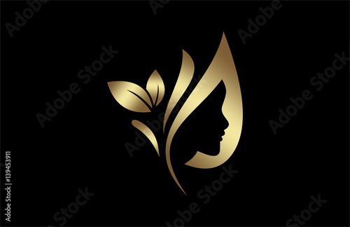 quotnatural beauty salon and hair treatment logo in gold and