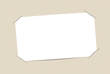Blank, white paper card inserted into squared brown background
