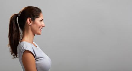 Smiling young woman profile portrait