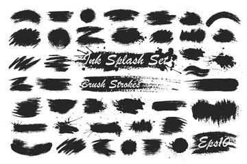 Black ink spots set on white background. Ink illustration. Brush strokes set.