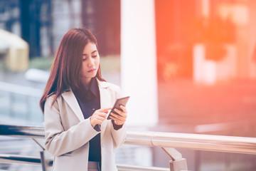 Asian Business woman use on the cellphone, portrait business concept, vintage color tone.