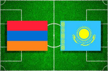 Flags Armenia - Kazakhstan on the football field. 2018 football qualifiers