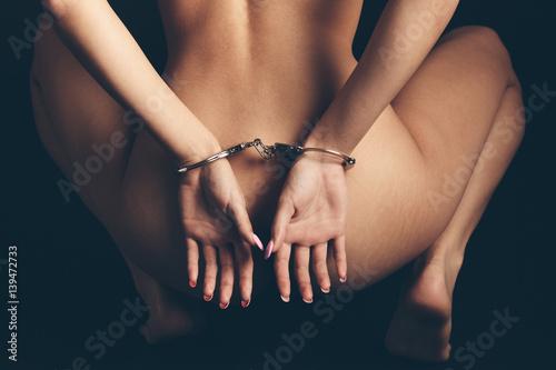nued girls in hand cuffs