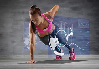 Sporty young woman making exercise on gray background
