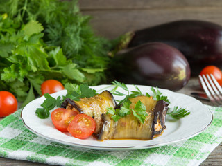 Baked stuffed eggplant with meat, vegetables and cheese.