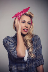 Blond model vintage concept Pin up style.