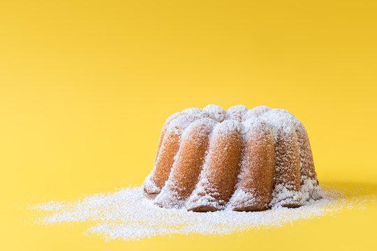 homemade lemon bundt cake with icing sugar.