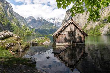 Small boat house in an idyllic mountain lake