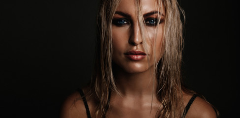 Beautiful young woman with wet look makeup