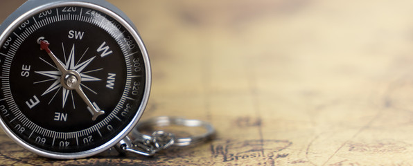 Vintage travel retro compass with bright map copy space