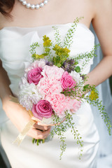 White and pink bridal bouquet of roses, carnations and dahlias