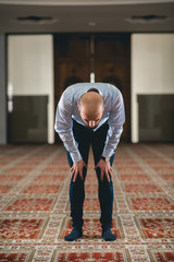 Muslim person bowing in prayer