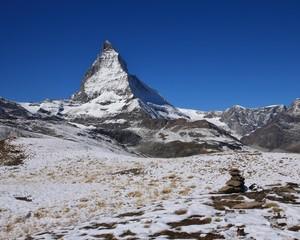 Snow covered Matterhorn in autumn, view from Gornergrat.