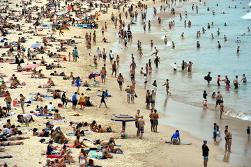Sydney, Australia - Feb 5, 2017. People relaxing, swimming and sun bathing on Bondi beach. Bondi beach is one of the most famous tourist sites in Australia.