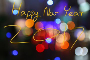 "Beauty of Bokeh light and Text for ""Happy New Year 2017"""
