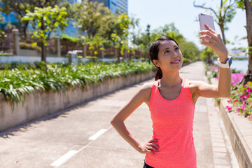 Sport woman taking selfie by mobile phone