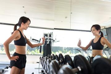 Fitness woman taking selfie in gym room
