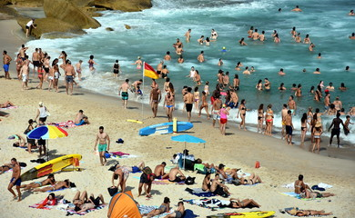 Sydney, Australia - Feb 5, 2017. People relaxing, swimming and sun bathing on Tamarama beach.