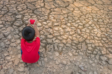 Child on dry ground, Drought concept.