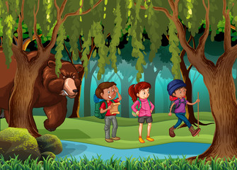 Brown bear standing behind the hikers in forest