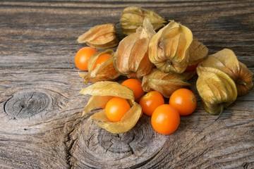 Physalis fruit over wood