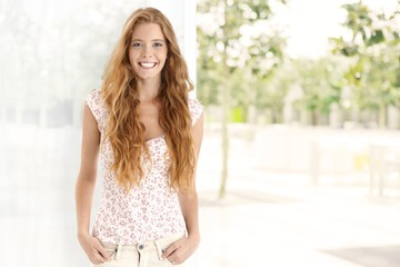 Summer portrait of happy ginger woman