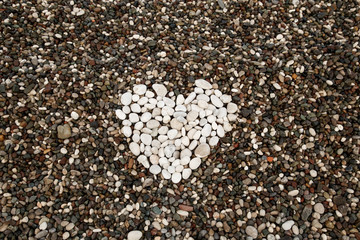heart from white stones on a background sea pebbles
