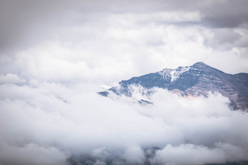 Mountain peak on a cloudy sky. Summer weather in the Peruvian Andes, south of Arequipa. Horizontal image.