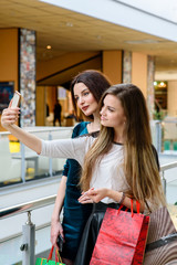Girls make selfi at the Mall.