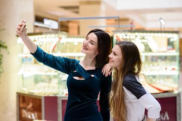 Girls make selfi at the Mall.