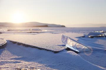 Ice on Baikal Lake, winter. Sunset landscape.