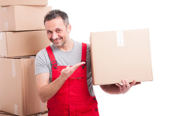 Mover guy holding and showing a big cardboard box