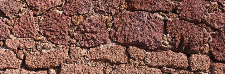 Red natural stone wall background