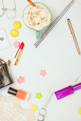 White office desk table with smartphone, vintage camera, coffee and cosmetics. Top view with copy space, flat lay.