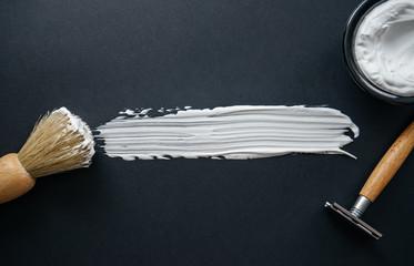 mens shaving kit on black background
