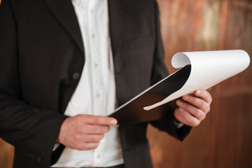 Cropped image of business man with clipboard