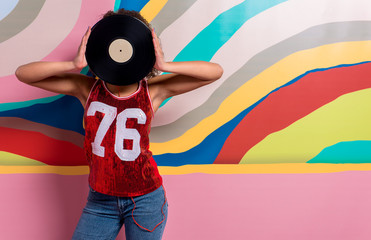 Young female keeping music platter in hand