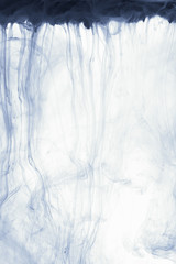 Smoke abstract background cloud of paint on white. Color ink drop in water