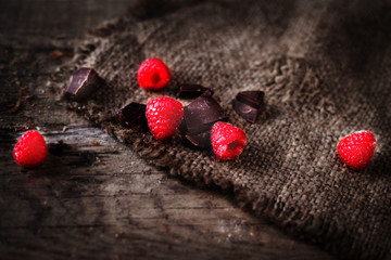 Ripe sweet raspberries on wooden table with copyspace. Close up, top view