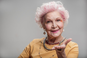 Beautiful elderly lady looking at camera