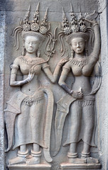Ancient reliefs with Apsaras at Angkor Wat Temple, Cambodia