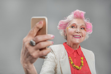 Senior beautiful woman with mobile
