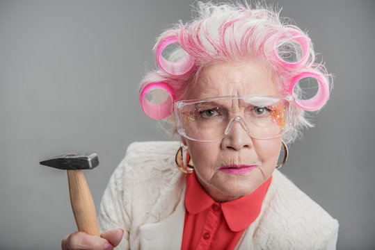 Senior woman in safety glasses posing