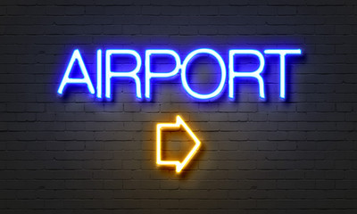 Airport neon sign on brick wall background.