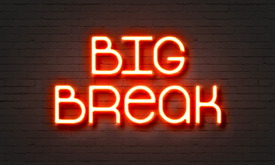 Big break neon sign on brick wall background.