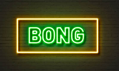 Bong neon sign on brick wall background.