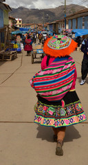 Peruvian woman walking alone on a market