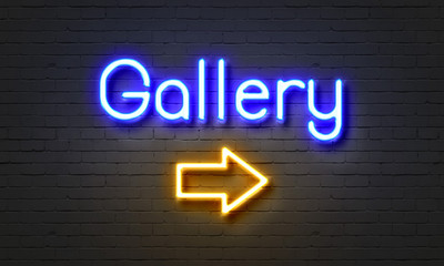 Gallery neon sign on brick wall background.