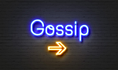 Gossip neon sign on brick wall background.